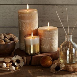"""Homescent Potpourri, Golden Breeze - Sweet mandarin and tiare petals mingle with the earthy fragrances of cedar leaf and sandalwood to create soothing scents for the bath or bedroom. Perfect for gifting, the decorative candle pot and diffuser come in a handsome box along with a savory potpourri blend. Candle Pot: 3.25"""" diameter, 3.75"""" high; 40-hour burn time Diffuser: 9 fluid ounces Pillar Candle: 4"""" diameter, 4.5"""" high; 60-hour burn time Pillar Candle: 4"""" diameter, 8"""" high; 120-hour burn time Potpourri: 4.5 ounces Blown-glass candle pot filled with scented paraffin wax. Diffuser comes with eight diffuser sticks. Diffuser will scent a room for up to one month. Pillar Candle made of scented paraffin wax with textured pattern on its exterior. Golden Breeze fragrance notes: Sweet mandarin, cedar leaf, amber, yuzu zest, tiare petals, sea moss, muguet, sandalwood. Potpourri ingredients: Paras pods, belliani pods, coco curls, mutamba and amra pods, decorative corn flowers."""