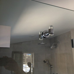 Frameless Shower Enclosure - Close up of double sided robe hook.  Through the glass application.  Glass hook features crystal elements.