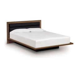 "Copeland Furniture - Copeland Furniture | Moduluxe 35-Inch Platform Bed with Leather Headboard - Made in Vermont by Copeland Furniture.The Moduluxe 35-Inch Platform Bed with Leather Headboard is a modern platform bed with a softly upholstered inset headboard. The crisply styled silhouette features solid maple, cherry or American black walnut hardwood construction with an inset headboard in tufted leather, offered in several colors. A deeply set plinth base gives the bed its visually stunning floating motif. The Moduluxe Platform Bed with Leather Headboard is designed for use with a mattress only (recommended mattress height - 10"") and is available in Queen, King or Cal King sizes. Select bed size and wood color/finish in one of two satin surface finishes: standard Copeland Lacquer top coat or formaldehyde free Copeland Water Based top coat. Then select leather color. Copeland Furniture's Moduluxe Series offers sectional furniture for the bedroom. This highly configurable bedroom and storage system adapts to most spaces and needs. The Moduluxe Platform Bed with Leather Headboard is a stylish standalone piece or may be configured with the Moduluxe range of dresser and desk elements for a custom modular bedroom. The Moduluxe Box Nightstand and Shelf Nightstand (both sold separately) can be added to this bed frame to create integrated side table storage."
