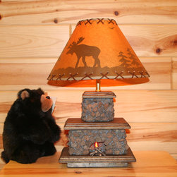 Fireplace Table Lamp - A fireplace isn't practical for a kids' room — unless it's in miniature. This adorable handmade lamp's base contains a flickering amber bulb for a realistic effect.