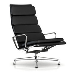 """Charles & Ray Eames - Herman Miller Eames Soft Pad Lounge Chair - Herman Miller Eames Soft Pad Lounge Chair  Swivel Tilt, 4-Cushion Backrest, Leather Upholstery  designed by Charles and Ray Eames      At A Glance:   2"""" thick foam pads, curved aluminum side ribs, a 4-star aluminum base and the genius of Charles and Ray Eames ... combine all of these elements together, throw in sumptuous leather and the result is the Eames Soft Pad Chair Collection. Shown here is the lounge chair from this classic collection. The leather upholstery color choices give you the option of a brighter, lighter look or a more subdued, traditional piece. While the lounge has uses in the office environment, Charles and Ray wanted to get away from the strictly corporate tone of the executive and management chairs and get into something more homey, more relaxing, and more comfortable.      Eames Soft Pad Lounge Chair can also be purchased with the Eames Soft Pad Ottoman.  13"""