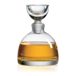 Ravenscroft Tradewinds Decanter - The curved body of the Ravenscroft Tradewinds Decanter is mirrored by the upturned shapely lid. This decanter has a thick bottom making it sturdy and heavy. This decanter is suggested for one 750-ml bottle.Decanters: Useful and BeautifulDecanters allow wine to breathe. This essential step exposes wine to the air and begins the release of the wine's unique aromatics thereby allowing for full flavor enjoyment. For older full-bodied wines decanting serves as a simple way to separate the wine from any sediment that might have accumulated in the bottle. Ultimately wine decanters significantly enhance presentation which completes the full sensory experience.Ravenscroft Crystal is the embodiment of old-world European craftsmanship blended with modern understanding of how a wine glass enhances the tasting experience. Each style of glass that Ravenscroft offers is the result of many years of glass-making trial and error. Each type of glass is individually designed and crafted to enhance the bouquet and taste of the wine or spirit for which it was made. The combination of being perfectly formed and light to the touch allows the bouquet to deliver the essence of the wine and spirits to the proper zones of the palate. To reduce the transfer of hazardous toxins into the beverage all Ravenscroft crystal products are lead-free.