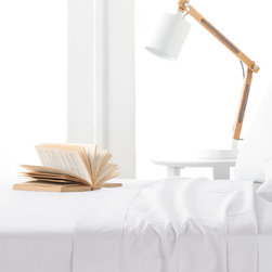 Textile City - Ivory 400-Thread Count Egyptian Cotton Sheet Set - Made from luxurious Egyptian cotton, this soothing set of sheets helps ease you into blissful sleep thanks to the comfortable construction. Plus, each piece is machine-washable for easy cleaning.   Includes fitted sheet, flat sheet and two pillowcases (twin sizes include one pillowcase) Fits mattress up to 15'' deep 100% Egyptian cotton 400-thread count Machine wash Imported