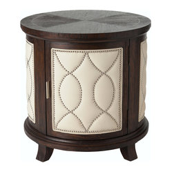 Ambella Home - Manhattan Round Accent Table - Drum roll, please. This plump table keeps the beat with your favorite armchair. It can hold books, magazines, electronics, your eyeglasses, coasters. Then put on the top and you have a place to rest a drink or even your feet.
