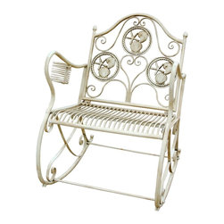 Zeckos - Antiqued White Metal Seashell Theme Patio Rocking Chair - This beautiful metal patio rocking chair has a seashell design on the back of the chair, and has an antiqued white painted finish. It features an attached cup holder on the right arm. The chair measures 23 1/2 inches wide, 29 1/2 inches deep and 36 inches tall. It can be used indoors or outdoors, and makes a great gift.
