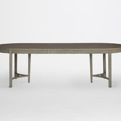 Whitlock Dining Table - At 106 inches long, the oval Whitlock Dining Table extends to accommodate additional chairs. The wood table is painted to mimic a French farmhouse style piece, and is finished with ribbed detailing on the apron.