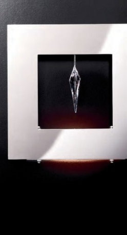 """Masiero - Masiero Click A1 Square Wall Sconce - The Click square wall sconce by Masiero has been designed by Fly Design Studio. This wall mounted luminaire is perfect for halogen lighting. The Click is composed of a polished stainless steel frame with a transparent Strass Swarovski crystal pendant hanging in the middle of the wall sconce.  Product description: The Click square wall sconce by Masiero has been designed by Fly Design Studio. This wall mounted luminaire is perfect for halogen lighting. The Click is composed of a polished stainless steel frame with a transparent Strass Swarovski crystal pendant hanging in the middle of the wall sconce. Details:                                     Manufacturer:                                      Masiero                                                     Designer:                                     Fly Design Studio                                                     Made in:                                     Italy                                                     Dimensions:                                      Height: 11.42"""" (29 cm) Width: 11.42"""" (29 cm)                                                     Light bulb:                                      1 X 100W R7s 78mm halogen                                                     Material:                                      Stainless Steel, Swarovski Crystal"""