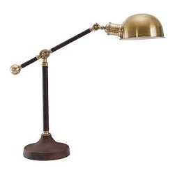 """Adams Leather Task Table Lamp - Richly grained leather wraps the base and post of this lamp, creating a handsome contrast to its antiqued-brass shade and fittings. The boom arm rises and descends, and the shade pivots from side to side. 19"""" wide x 7"""" deep x 23"""" high Made of real leather and iron and finished in Antique Brass. Features an adjustable head and arm. On/off switch in-line. UL-listed. Title 20 compliant lamps will be shipped to CA addresses. {{link path='pages/popups/california_code_popup.html' class='popup' width='480' height='300'}}Learn more{{/link}} to understand product differences."""