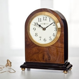 Howard Miller Bedford Mantel Clock - The Howard Miller Bedford clock features a high-gloss walnut piano finish with a wood burl pattern on the front and back. The sides and base are ebony black with polished brass button feet. The polished brass-tone waterfall bezel frames the off-white dial. The dial features black numerals black hour and minute hands and a brass second hand. Features quartz movement and includes the batteries. There's a certain level of expectation that comes with the Howard Miller name. And then there's the steady stream of surprises that make you stop in your tracks and take a second look. From traditional to hot trends and floor clocks to wine furniture you'll find even more than you expected at Howard Miller. Fine details expert craftsmanship and beautiful materials; no matter what your taste or budget a Howard Miller clock fits the bill. About Howard MillerBeginning in the 1920's Howard Miller clocks have impressed all who see them with superior quality and design. Howard Miller wall floor and mantel clocks are crafted to last for generations and to perfectly accent your home. The company's founder Howard C. Miller began manufacturing wall and mantel clocks in Michigan. Evolving to encompass cabinet making and other furniture design - all renowned for quality and style - the Howard Miller company proudly stands behind its reputation as the World's Largest Clock Manufacturer.
