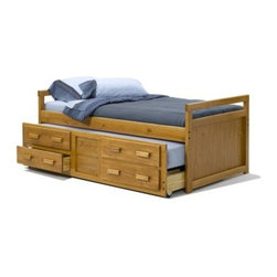 "Heartland Trundle Bed with Drawers - The homey elegance and peerless craftsmanship of the Heartland Trundle Bed with Drawers will warm your heart, and its unique functionality will save space, time, and effort. Tough pine wood construction will never let you down, and a light pine finish will beautify your space to degrees unimaginable to the mind. Hidden beneath this beauty is a roomy sleeper trundle with two drawers, perfect for sleepovers and providing the extra storage everyone needs. This piece measures: 78L x 43W x 28H inches.About Woodcrest ManufacturingIn business for nearly 20 years, Woodcrest Manufacturing has grown beyond its simple origins in Peru, Indiana, to become a leader in global furniture industry partnerships. They specialize in """"stairway bunk bed"""" designs, and all their products are tested by independent laboratories to ensure top safety in your child's bedroom."