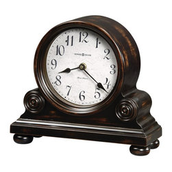 Howard Miller - Murray Mantel Clock w Bun Feet and Triple Chi - Adorable mantel clock will become the focal point of the room. Its aged, black finish is intriguing and blends nicely with most other styles. Details like rosettes and bun feet are prominent. Classic, black spade hands. Plays Ave Maria, Westminster or Bim Bam chimes. This mantel clock's decorative details include applied rosettes and bunn feet. The aged dial offers black Arabic numerals with black spade hands beneath a convex glass crystal. Quartz, triple chime Harmonic movement plays your choice of Westminster, Ave Maria, or Bim Bam chimes, with volume control and automatic nighttime chime shut-off option. Worn Black Finish. Made of Hardwoods and Veneers. 12 1/4 in. W x 4 1/2 in. D x 11 in. H