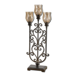 Uttermost - Fela Candleholder - This floor candleholder will call attention to any chair, table or part of the room you put it in. Graceful, antiqued bronze metal arms sweep up to hold crackled amber globes. When lit, it will light up your room.