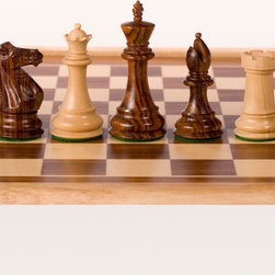 World Wise - Supreme Staunton Chess Pieces - 1006S4 - Shop for Chess and Strategy from Hayneedle.com! A perfect gift for the true chess lover in your life the Supreme Staunton Chess Pieces come in the finest hand-selected sheesham rosewood or black-stained boxwood materials. These chess pieces are flawlessly crafted from the perfect turrets on the rook to the smallest details of the feathered knight's mane. They're triple-weighted for a solid feel. The pieces have green felt pads on the bottom to protect your board from scuffs and scratches. With a generous 4-inch king height and high-gloss finish these chessmen will be the envy of all your opponents. The Black & Natural Boxwood option includes one extra queen per side.