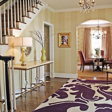 Traditional Staircase by Lucy and Company