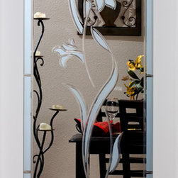 Tulip Decorative Interior Glass Door - The elegant Tulip interior glass door has striking etched and grooved glass and features a beautiful tulip in the center of the door.  The glass portion of the door is framed by a pretty arched border, which highlights the center's floral design.  Unique and beautiful, this door adds class to any room. The Tulip glass door is offered in a variety of 9 wood species to compliment any interior including:  primed white, pine, oak, knotty pine, fir, maple, knotty alder, cherry and African mahogany.  Optional 8-foot tall doors are available in primed white and pine species only.