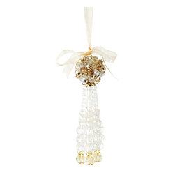 Champagne and Silver Tassel Ornament - Metallic palettes at chic Christmas cocktail parties and in fabulously-decorated holiday homes coalesce into the beaded beauty of the Tassel Ornament. Equipped with a texture-packed ball of faceted beads woven together to make an eclectic top, the sleek fall of the fringe of beads below adds grace to your Yuletide look. The ornament design comes in either a rich plum, amethyst, and gold scheme or an icy, glistening gold and silver.