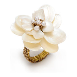 Flower Napkin Ring - Ivory - Somehow striking the perfect accord between the organic, lacy patterns of seafoam and the deep, textural richness of a carved shell ornament, the Ivory Coast Placemat incorporates beads of off-white and gold in multiple evocative shapes, their skillful arrangement creating the exquisite sand-colored surface adornment of this neutral-hued, yet glamorous, round placemat. This item is sold as a single unit.