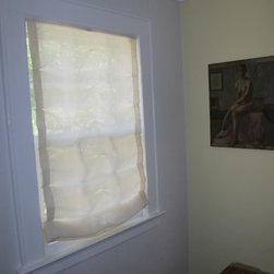 Roman Shades - Tiny tucks were taken in this unlined Roman shade to add movement for a cottage style home. Rosemarie Garner