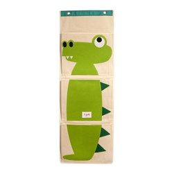 3 Sprouts - Crocodile Wall Organizer - Isn't it frustrating to search endlessly for those small, but important, objects that frequently seem to go astray? This hanging wall organizer is the perfect solution for keeping track of all your odds-and-ends. Easy to hang, the organizer has 3 generous pockets that are for diapers in the nursery, precious art projects, those tiny 'gotta find it now' toys. The 3 Sprouts hanging wall organizer will ensure that keeping track of your small things never turns into a big headache!