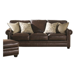 Chelsea Home Furniture - Chelsea Home Lamesa Sofa in Stampede Coffee - Sofa in Stampede Coffee belongs to Lamesa Collection by Chelsea Home Furniture This traditional style blends well with any home decor and is designed for lasting comfort and beauty. Individually nailed brass finished nails accent the slim roll arms and front rail, adding beauty and style. Tapered all wood legs and throw pillows complete the piece's legacy of traditional style. Sofa (1)