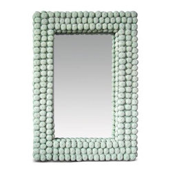 Made Goods Agnes Mirror - I'm a sucker for all things coastal, but not the typical shell-covered numbers you buy at the honky tonk tchotchke shop. The unexpected pieces make things more modern, and this mirror's frame, which is composed of hand-molded sea urchin shapes has a beautiful color and texture that wows.