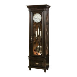 Howard Miller - Crawford Floor Clock in Worn Black - Worn Black finish on select Hardwoods and Veneers with distressing, and accented with Saratoga Cherry patterned back panel. Nickel finished escutcheon plate and drawer pull. This flat-top floor clock features a decorative molding in the pediment that continues in the base. A drawer is provided in the base for storage. Simple yet elegant columns frame the door and drawer front. Turned legs at the base complete the design. The White dial features applied brushed Nickel Arabic numerals, and brushed Nickel hands and bezel. The angular frames of the door and drawer front make this case unique. The door features a grille that frames the dial and has plain Glass. Removable, grill topside panels offer easy access to the movement. Matching grille panels carry through in the lower sides. Brushed Nickel-finished weight shells and grid pendulum. The dial is illuminated, while the pendulum and weight shells are accentuated by the glow from the lamp. Cable-driven, Westminster chime Kieninger movement with automatic nighttime chime shut-off option. Finished in Worn Black on select materials, Hardwoods and Veneers. Adjustable levelers under each corner provide stability on uneven and carpeted floors. You will receive a free heirloom plate, engraved with name and date, by returning the enclosed request card to Howard Miller. Locking door for added security. Heirloom Record Certificate with capsule is included for recording your clocks ownership history for future generations. 28 1/2 in. W x 16 1/4 in. D x 86 in. H