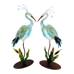 Pair of Metal Heron Garden Sculptures with Suncatcher Bodies - This pair of metal crane sculptures is a beautiful addition to your lawn, garden, flower beds, or your porch or patio. Each crane stands approximately 24 inches tall, 11 inches long, and 6 inches wide. They are painted with colorful enamel paints and each of the cranes` bodies features a textured glass sun catcher. These sculptures make a lovely gift that is sure to be admired.