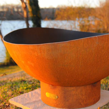 """Fire Pits - Great for Fall and Winter - The flowing scalloped edges of the Scallop design fire pit are like the tide rolling onto the beach. This gentle soothing design compliments any landscape either by the sea or far away. This original design is made to order by Tennessee craftsman in the heartland of America. They are constructed from heavy duty 1/4"""" thick mild carbon steel and are the most durable steel fire pit made anywhere. The inner bowl has a high temperature resistant coating and comes with a 1 1/2"""" diameter rain drain. The outer iron oxide patina is maintenance free and the fire pit can be left outside in all weather conditions. Over time and use the patina will mature and darken a few shades and then remain permanent forever. Each unique fire pit is individually numbered by the artist on an attached brass plaque."""