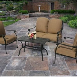 Oakland Living Hampton Chat Set - With its contemporary charm, upscale appeal, and luxurious comfort, it's no wonder the Oakland Living Hampton Chat Set will become your favorite spot to lounge or catch up with friends. The elaborate, scroll-accented backrest and elegantly curved armrests exude refined elegance, while the deep, generous seat, supportive back, and super-comfy seat cushions in choice of standard or Sunbrella seat you and your guests in luxurious comfort for hours on end. The coffee table keeps your snacks and beverages within arm's reach, letting you catch up on the latest gossip without any interruption. Each piece is hand cast from rust-resistant cast aluminum and sports hardened powder-coat Antique Bronze finish that's fade-, chip-, and crack-resistant and stays like new season after season.