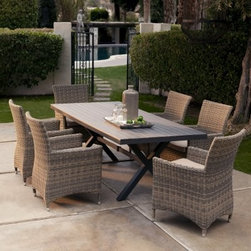 Belham Living Bella All Weather Wicker Patio Dining Set - Seats 6 - Delivering a true combo of natural aesthetics and all-weather performance the Belham Living Bella All Weather Wicker Patio Dining Set - Seats 6 features eco-friendly easy-to-maintain materials. This seven piece set includes a rectangular faux wood dining table and six resin wicker dining arm chairs. A rust-proof all-aluminum frame on the chairs supports a weather-proof resin wicker exterior. You can leave resin wicker out year-round and it won't fade crack or peel. Seat cushions of spun-poly are included for added comfort. The table is inspired by traditional picnic tables with intersecting legs and a slatted top. The faux wood table top has a pressed finish so you get the look of real wood without the weathering or upkeep. A durable aluminum base keeps this top well-supported. This whole seat is easy to clean with soap and water. Table features umbrella hole. Dimensions Chair: 25.5W x 22.5D x 33.75H in. Table: 82.75L x 39.5W x 29.5H in. Seat: 18W x 20D in. Seat Height: 19H in. Back Height from Seat: 21H in. Arm Height: 25H in. Assembly Disclaimer: Insure stability of the assembled table by checking that all legs are fastened tightly against the bottom of the table top. Polyester fabric is water- and fade-resistant. While the fabric is highly water repellent if left out in the rain or under sprinklers it will absorb moisture where there is stitching. We recommend storing or covering when not being used. If the cushions do get wet stand them on their side and allow the water to drain out of the stitched seam. To clean use mild dish soap and water do not use harsh chemicals. About Belham Living Belham Living builds catalog-quality furniture in traditional styles at a price that actually makes sense. By listening to our customers and working closely with great manufacturers we build beautiful pieces worthy of your home. Rich wood finishes attention to detail and stylish lines that tie everything togeth