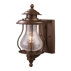 Elk Lighting - Wikshire 1-Light Outdoor Sconce in Coffee Bronze - Reminiscent of turn of the century gas lights, the wikshire collection is crafted with the same high quality and historical attributes of that period. Crackled blown glass diffuses the light while a coffee bronze finish exudes warmth and tradition.