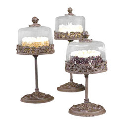 "Gracious Goods GG - GG Collection Medium Covered Dessert Pedestal with Glass Dome - Serve your festive cakes and desserts with a touch of chic and class in our incredible medium sized dessert pedestal by the GG Collection! Showcasing items on our Gracious Goods stand will bring fun to any occasion- from your bakery or catered event to birthday parties, showers, weddings and grand celebrations! A cream colored chip resistant stoneware plate rests on the stand and is topped with a sparkling glass dome. The glass dome features a removable decorative metal finial that serves as the knob for lifting.   * Dimensions: D: 7.5"" H: 14""  * For alternate sizes see items GG92622 and GG92624"
