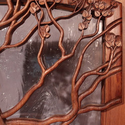 The Lakeridge Entry Door - Brian Lee Designs close up view of the Manzanita Bush carving.