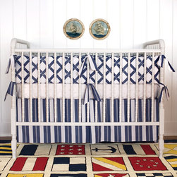 Annette Tatum 3 Piece Crib Set Bamboo Indigo - This beautiful bumper set offers a bold look without going overboard. With straightforward waffle pattern and stripes, this muted navy and white set even has distinct details like a crib skirt kick pleat. This is bound to fit beautifully into any home's aesthetic and give you and baby lots of smiles.
