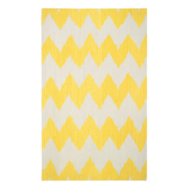 """Wild Chev rug in Leo Sun - """"Stripes are the greatest illusion maker in a designers toolbox. The chevron is classic and timeless, by playing with proportion and scale, my goal was to make it feel a bit refreshed and dressed up."""" - Genevieve Gorder"""