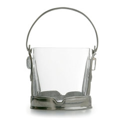 Taverna Crystal Ice Bucket with Handles - An unusual transitional piece that draws together eclectic barware into a fascinating arrangement of elite pieces, but easily complements your existing set, the Crystal Ice Bucket has high sides of glass as clear as water. The cylindrical glass insert rests in a distinguished base of genuine Italian pewter, which lends its assertive old-world style to the look of the ice bucket. A matching handle arches high over the ice bucket's well for easy carrying.
