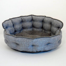 Paws & Claws - Paws & Claws Ethan Basket Weave Tufted Headboard Pet Bed - 59-20299GRY - Shop for Beds Covers and Fill from Hayneedle.com! The Paws & Claws Ethan Basket Weave Tufted Headboard Pet Bed is a bed fit for a king letting you provide your pet with the best accessory furniture. This round dog bed features a tall curved back cushion that resembles a tufted headboard and adds support when your dog is curled up. Perfect for smaller breeds the basket-style bed comes with a soft polyester cover with lock-stitch seams that provide a sturdy construction. The cover is zippered and easily removable allowing you to quickly clean in your washing machine. A polyester fill material (made from recycled plastic bottles) makes a comfortable supportive surface on which to lay. Choose between canyon brown or gray (colors subject to availability).About Paws and Claws Pet SupplyPaws and Claws knows that their customers value their pets as much as their own family. That's why each or their products are design to be the best combination of comfort and safety making sure your furry friend is properly outfitted. Leashes collars pet beds and toys for both cats and dogs are just some of the products provided by Paws and Claws. Each of their products is designed manufactured and sold exclusively in America meaning you won't run into inferior craftsmanship or health/safety issues that can arise when purchasing from international vendors. Recycled materials are used to reduce the amount of waste produced.
