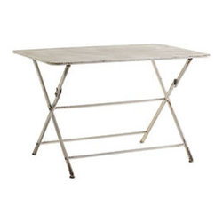 ANTIQUED FOLDING TABLE - Think French bistro, Italian courtyard, English garden, or American backyard. Wherever you and your crew gathers, this iron table is sure to accommodate. The ivory finish is handpainted with a handsome patina, a slightly worn looking treatment that gives it an antique quality. It's great for those in a small space, as you can fold it up for use and fold it down for storage. As far as its size, don't worry: this patio table is more than up to the task of hosting everyone (and their appetites) for lunch.