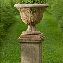 Campania International - Campania International Palais Arabesque Urn Planter with Pedestal - PPD-609-AL - Shop for Planters and Pottery from Hayneedle.com! Bring visual intrigue and height to your landscape design with the Campania International Palais Arabesque Urn Planter with Pedestal. The set features an urn planter with elegant scrollwork that stands on a stately pedestal base. Both are made of lightweight and durable cast stone that withstand the elements and is easy to move. Choose from a variety of weathered finish options. Campania Cast Stone: The ProcessThe creation of Campania's cast stone pieces begins and ends by hand. From the creation of an original design making of a mold pouring the cast stone application of the patina to the final packing of an order the process is both technical and artistic. As many as 30 pairs of hands are involved in the creation of each Campania piece in a labor intensive 15 step process.The process begins either with the creation of an original copyrighted design by Campania's artisans or an antique original. Antique originals will often require some restoration work which is also done in-house by expert craftsmen. Campania's mold making department will then begin a multi-step process to create a production mold which will properly replicate the detail and texture of the original piece. Depending on its size and complexity a mold can take as long as three months to complete. Campania creates in excess of 700 molds per year.After a mold is completed it is moved to the production area where a team individually hand pours the liquid cast stone mixture into the mold and employs special techniques to remove air bubbles. Campania carefully monitors the PSI of every piece. PSI (pounds per square inch) measures the strength of every piece to ensure durability. The PSI of Campania pieces is currently engineered at approximately 7500 for optimum strength. Each piece is air-dried and then de-molded by hand. After an internal quality check pieces are sent to a finishing department where seams are ground and any air holes caused by the pouring process are filled and smoothed. Pieces are then placed on a pallet for stocking in the warehouse.All Campania pieces are produced and stocked in natural cast stone. When a customer's order is placed pieces are pulled and unless a piece is requested in natural cast stone it is finished in a unique patinas. All patinas are applied by hand in a multi-step process; some patinas require three separate color applications. A finisher's skill in applying the patina and wiping away any excess to highlight detail requires not only technical skill but also true artistic sensibility. Every Campania piece becomes a unique and original work of garden art as a result.After the patina is dry the piece is then quality inspected. All pieces of a customer's order are batched and checked for completeness. A two-person packing team will then pack the order by hand into gaylord boxes on pallets. The packing material used is excelsior a natural wood product that has no chemical additives and may be recycled as display material repacking customer orders mulch or even bedding for animals. This exhaustive process ensures that Campania will remain a popular and beloved choice when it comes to garden decor.About Campania InternationalEstablished in 1984 Campania International's reputation has been built on quality original products and service. Originally selling terra cotta planters Campania soon began to research and develop the design and manufacture of cast stone garden planters and ornaments. Campania is also an importer and wholesaler of garden products including polyethylene terra cotta glazed pottery cast iron and fiberglass planters as well as classic garden structures fountains and cast resin statuary.