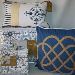 Navy Nautical Bedding Set - Classic navy blue and white set the tone for this nautically inspired bedding set.  A navy, geometric print in the style of a nautical compass is presented on a white background and accented with a complementary coastal blue pattern.  The quilt and shams reverse to a smaller scale coordinating print in navy on white.