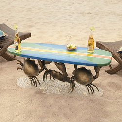 Frontgate - Crab Blueboard Table - Crab and surfboard casted from bronze. Hand-painted table top with clear powercoat finish. Metallic glitter in sandy base imparts a realistic appearance. Arrives Assembled. Standing on a sandy beach, our one-of-a-kind Crab Surfboard Table adds a touch of fanciful flair to your decor. Three beautifully bronze-casted crabs are holding up a surfboard tabletop with a hand-painted design inspired by vintage long boards. A durable clear powdercoat finish makes it the perfect place to set down a cold drink on a hot summer day.  .  .  .  . Imported.