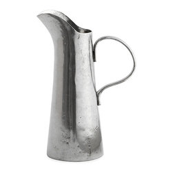 Vintage Pewter Pitcher - Tall and upright in form with a subtle usage of taper and curve to create the lean shape, the Vintage Pewter Pitcher bears a light mark of hand-distressing on its otherwise smooth surface, while its wide handle contrasts with the slimmer body. Made by hand in Italy, this pitcher makes a superb alternative to a traditional water carafe and also finds a perfect place in the home bar.