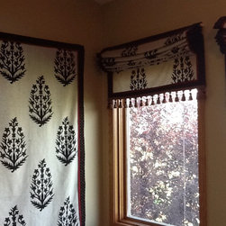Roman Shades - Remade curtain panels into Roman Shades.  JDuce Design