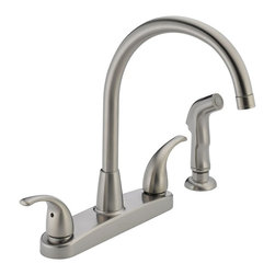 Peerless - Peerless Choice P299578LF Double Handle Kitchen Faucet with Side Spray - 547036 - Shop for Kitchen from Hayneedle.com! Style and innovation make the Peerless Choice P299578LF Double Handle Kitchen Faucet with Side Spray an ideal addition to your home's kitchen set. Made from solid brass you know that this faucet won't have any trouble warding off bacteria and rust to last and last. Its high-arcing and swiveling spout allows for unobstructed access to the basin for those large pots and pans. Just pull out the included side sprayer for convenient washing of dishes and produce. Its pair of ergonomic blade handles let you dial in the perfect temperature and pressure with precision. Product Specifications: Mount Type: Deck Mount Handle Style: Lever Valve Type: Ceramic Disc Flow Rate (GPM): 1.8 Swivel: 360 degrees Spout Height: 8.63-inch Spout Reach: 9-inch About Peerless IndustriesBased in Melrose Park IL Peerless Industries is a leading provider of audiovisual mounting solutions for commercial and residential uses. For over 40 years Peerless has focused on quality ease of installation and functionality in all its products. Peerless mounts and installation accessories feature aesthetically pleasing designs that fade into the background gracefully accentuating your viewing experience. With such a comprehensive line of products Peerless is sure to offer a mount that will perfectly suit your needs.