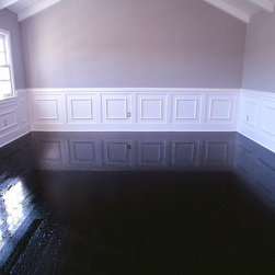 Hardwood Floor Refinishing Laguna Niguel, CA - Complementing the white wainscoting, windows, ceiling and grey walls; this Laguna Niguel, CA homeowner wanted his wood floor to look like a piano. The hardwood floor was custom refinished to a black stain then high-gloss urethane was applied.