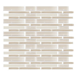 Susan Jablon Mosaics - Cream Linear Glass Tile - This glass tile blend is a beautiful neutral mix of cream linear lengths of glossy and frosted glass tiles. It is truly a perfect neutral for your countertop coordination. Clean crisp and contemporary this blend features wheat brown subway glass tiles in both glossy and frosted and in varying lengths and sizes. It is very easy to install as it comes by the square foot on mesh and it is very easy to clean! About a decade ago, Susan Jablon re-ignited her life-long passion for mosaics and has built a customer-focused, artist-driven, business offering you the very best in glass and decorative tiles and mosaics. We are a glass tile store committed to excellence both personally and professionally. With lines of 100% SCS Qualified recycled tile, 12 colors and 6 shapes of mirror, semi precious turquoise stones from Arizona mines, to color changing dichroic glass. Stainless steel tiles in 8mm and 4mm and 12 designs within each, and anything you can dream of. Please note that the images shown are actual photographs of the tiles however, colors may vary due to the calibration of each individual monitor.