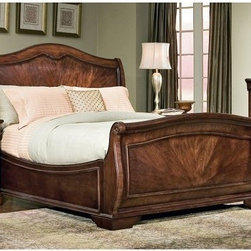 Heritage Court Sleigh Bed - The Heritage Court Sleigh Bed will redefine any bedroom with dramatic traditional style. This bed incorporates classic sleigh bed lines which are emboldened by sweeping arched side rails and robust block feet. Headboard and footboard panels exhibit a faint radial pattern in the wood grain to add another dimension of visual appeal. Available in your choice of Queen or King sizes. The Heritage Court Collection captures the timeless elegance of traditional furniture design. Each piece is constructed of enduring wood and finished in a handsome dark stain that subtly draws the eye to the beauty of the wood grain. About Legacy Classic FurnitureCommitted to offering the best of today's youth-bedroom styles for the young and young at heart Legacy Classic Furniture offers a wide selection of best selling designs and finishes with a large variety of beds and storage and study options. Dedicated to providing outstanding quality at reasonable prices Legacy Classic Furniture employs quality materials proven construction techniques and the highest safety standards to manufacture exceptional products that are built to last a lifetime.