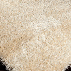 Rhapsody Rug - Cream - 2' x 3' - Sink into a soft, sophisticated floor with the Cream Rug from the Rhapsody collection, a rectangle of long wool-blend fibers brought together into a silky, fluffy floor covering with the softness of a cloud and the glamor of a luxury penthouse.  Perfect for uptown looks and lusciously-appointed rooms, this ultra-plush area rug was hand-woven in Belgium.