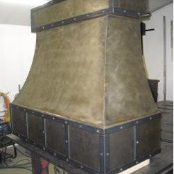 Traditional Vent Hoods - Custom Metal Vent Hood with Stainless Steel with Patina and Steel Banding and Steel Rivets Custom Metal Vent Hood by http://www.customventhoods.com