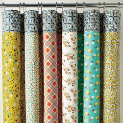 Half Moon Bay Reversible Shower Curtain - Two looks in one! The colorful panels of vintage-inspired prints work for anyone who has a hard time deciding on just the right pattern. If you want to give your bathroom a new look in an instant without spending any additional cash, simply reverse the curtain and you'll find an allover daisy print!